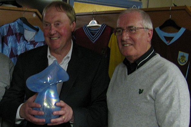 Barry Kilby receives the 2010 award from North Manchester Clarets' Chris Wells