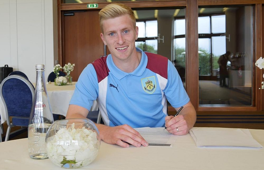 Ben Mee signing his previous contract