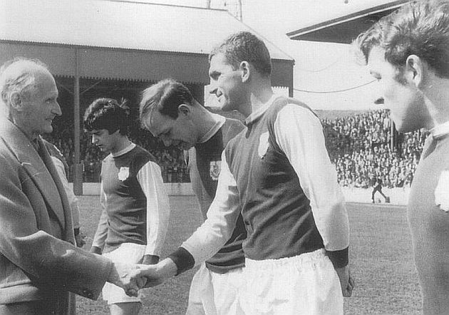 Shaking hands with Viscount Montgomery before a home game against Leeds