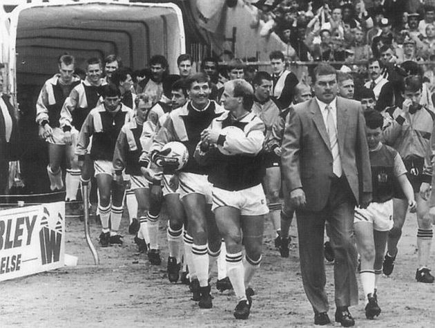 Brian Miller proudly leads out his Burnley team at Wembley in 1988