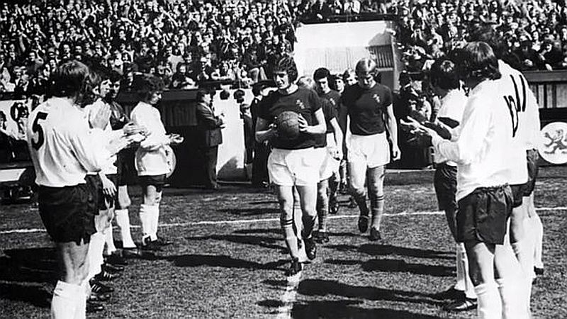 Martin Dobson leads out the Clarets