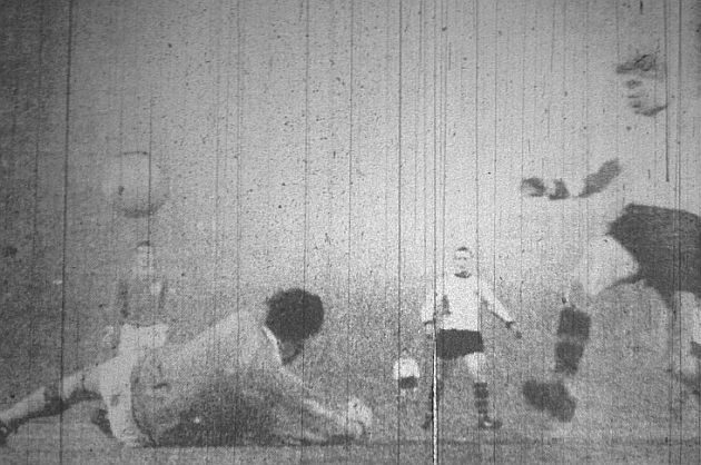 Alex Elder beats the unsighted Tommy Lawrence to give Burnley the lead