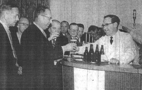 Plant Manager Mr J. Snijders receiving the first pint at the new Mullard's club