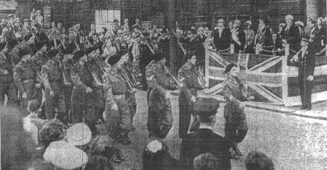 The 4th Battalion of the East Lancashire Regiment march past the dais in front of the Town Hall at the public ceremony for the dignitaries from Vitry-sur-Seine